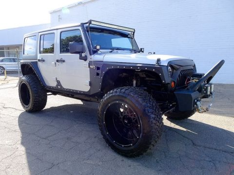 Pre-Owned 2011 Jeep Wrangler Unlimited Sport RHD